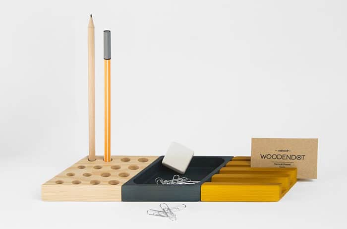 the yellow piece is for smartphones or business cards, the natural piece is for pens and pencils, the black piece is for small stuff like paper clips, push pins et cetera