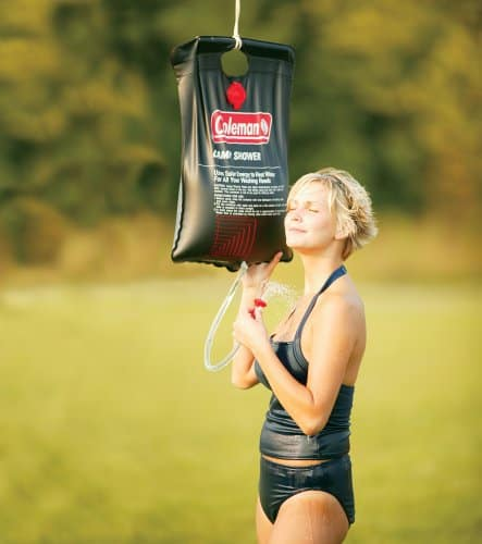 throw a portable camp shower in your truck for camping trips